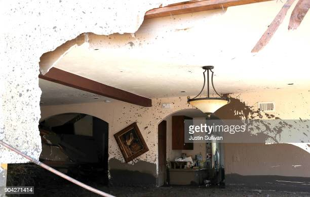 Mud fills a home that was destroyed by a mudslide on January 12 2018 in Montecito California 17 people have died and hundreds of homes have been...
