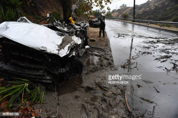 Mud fills a street after a raindriven mudslide destroyed two cars and damaged property in a neighborhood under mandatory evacuation in Burbank...