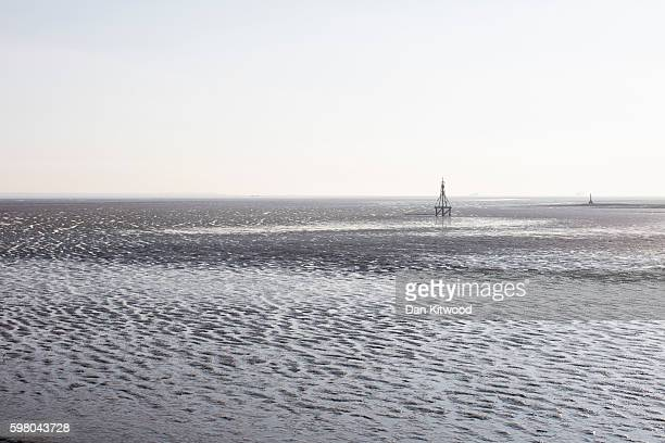 Mud flats are exposed by the receding tide on the Isle of Grain on August 31 2016 in Isle of Grain England The Isle of Grain is the easternmost point...