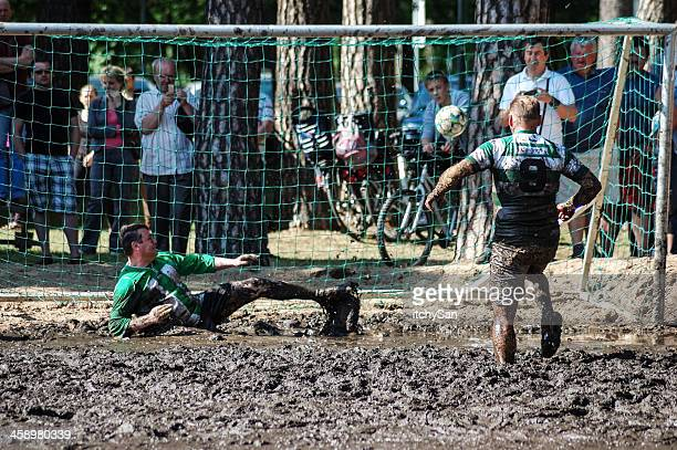 mud football goal - sumpf stock-fotos und bilder