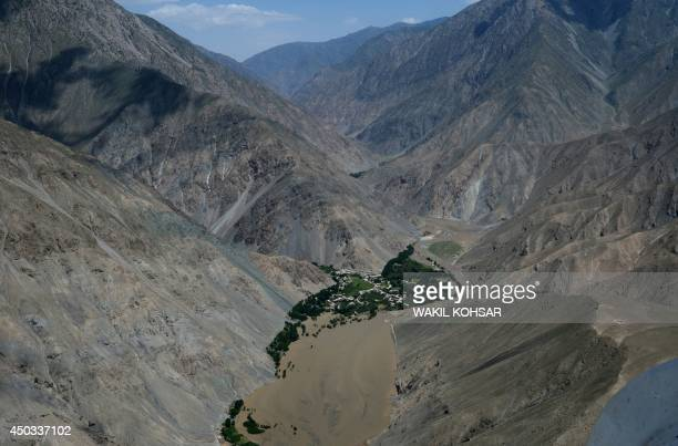 Mud from a landslide caused by flooding is seen in this aerial view of Afghanistan's GuzargaheNur district of Baghlan province on June 9 2014...