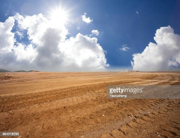 Mud road surface view,at sky with clouds