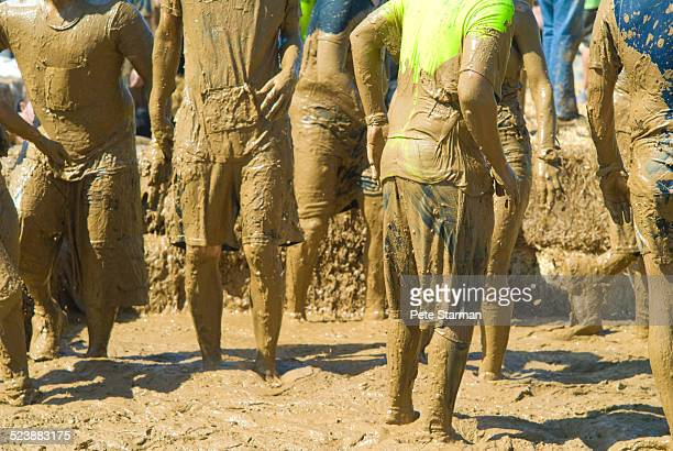Mud Run competitors exiting a mud pit.