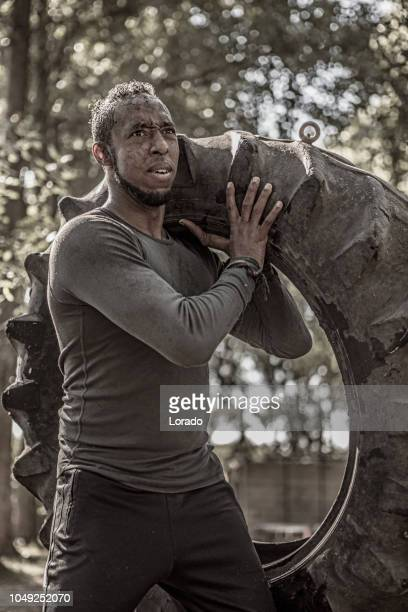 mud run man - army training stock pictures, royalty-free photos & images