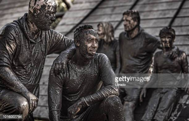 mud run participant - sports team event stock photos and pictures
