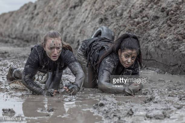 mud run women - military training stock pictures, royalty-free photos & images