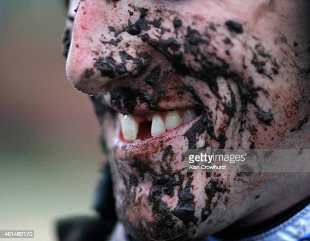 A mud splattered and smiling Sam Jones at Fakenham racecourse on January 13 2015 in Fakenham England
