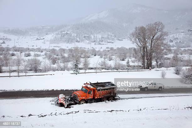 mud stuck snowplow in heavy colorado spring snow - steamboat springs colorado stock photos and pictures