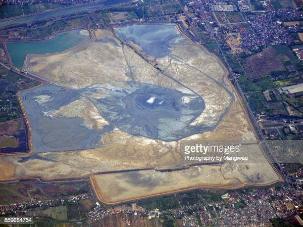 mud volcano - east java province stock photos and pictures