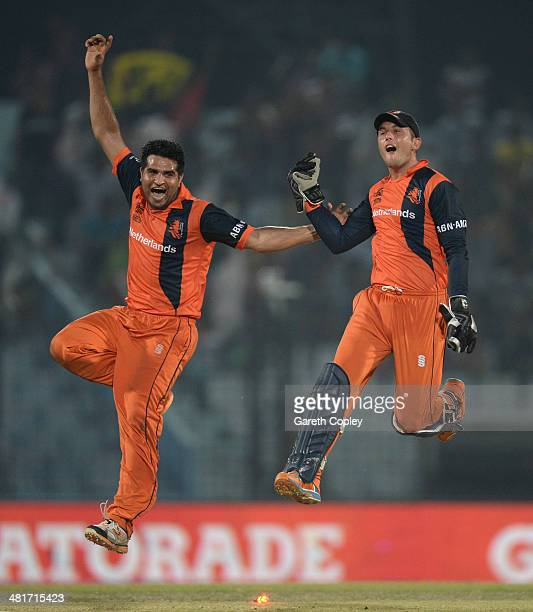 Mudassar Bukhari and Wesley Barresi of the Netherlands celebrate winning the ICC World Twenty20 Bangladesh 2014 Group 1 match between England and the...