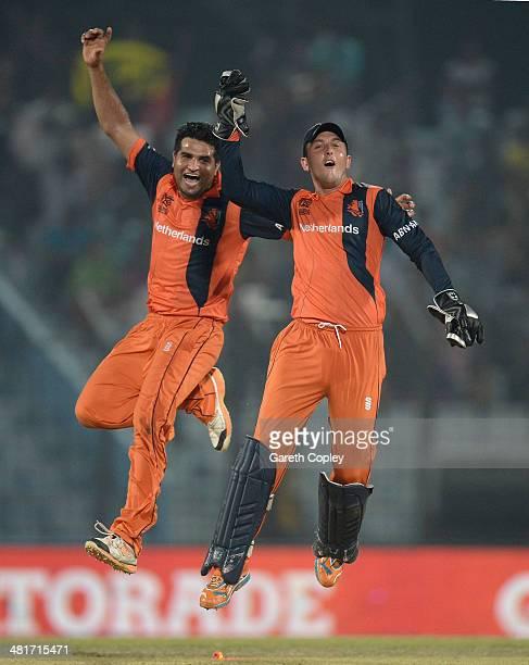 Mudassar Bukhari and Wesley Barresi of the Netherlands celebrate winning the ICC World Twenty20 Bangladesh 2014 Group 1 match between England and the...