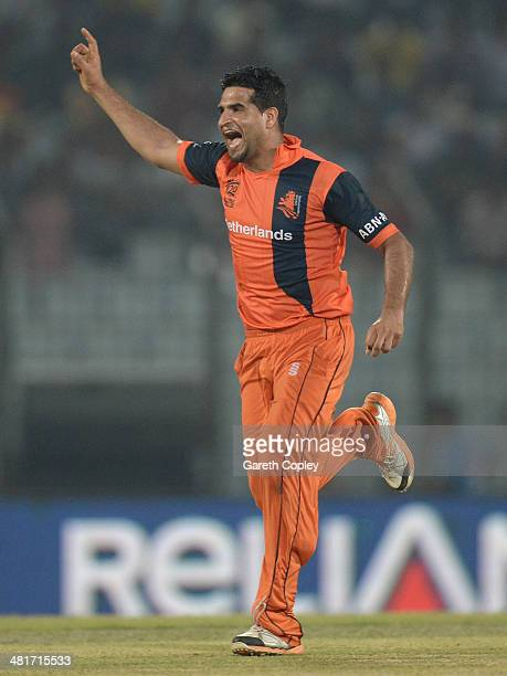Mudassar Bukhari of the Netherlands celebrates dismissing England captain Stuart Broad during the ICC World Twenty20 Bangladesh 2014 Group 1 match...