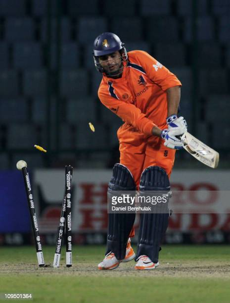 Mudassar Bukhari of the Netherlands is bowled by Kemar Roach of West Indies during the 2011 ICC World Cup group B match between Netherlands and West...