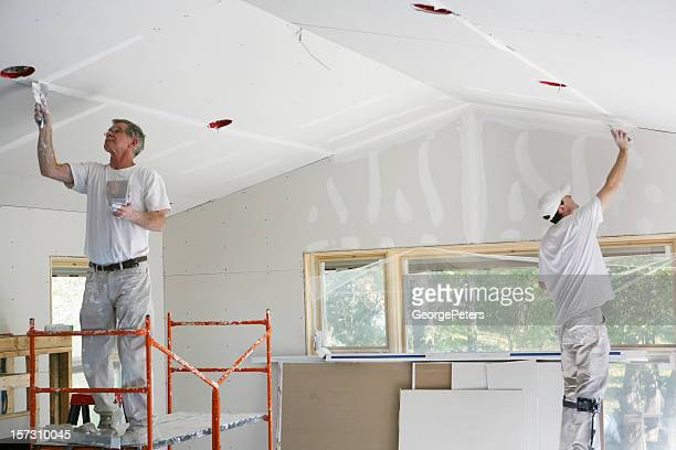 mudding and taping sheetrock - ceiling stock pictures, royalty-free photos & images