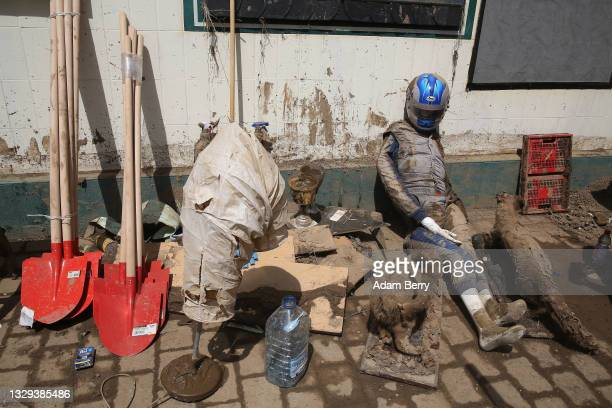 Muddy and damaged taxidermied animals and a racing outfit owned by German race car driver Stefan Kissling sit salvaged outside a traditional German...