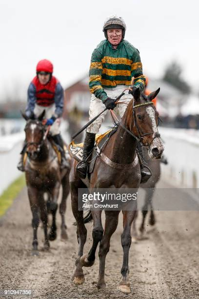 A muddy Barry Geraghty returns after winning The JCB Triumph Trial Juvenile Hurdle Race on Apple's Shakira at Cheltenham racecourse on January 27...