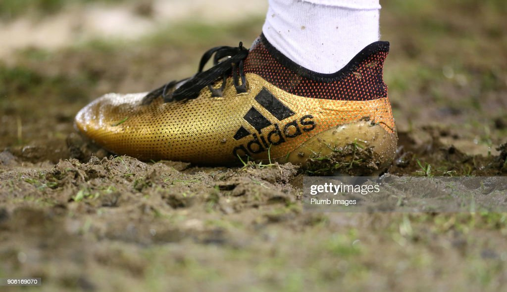 A muddy boot during the Checkatrade Trophy tie between Oldham Athletic and Leicester City at Boundary Park on January 17, 2018 in Oldham, United Kingdom.