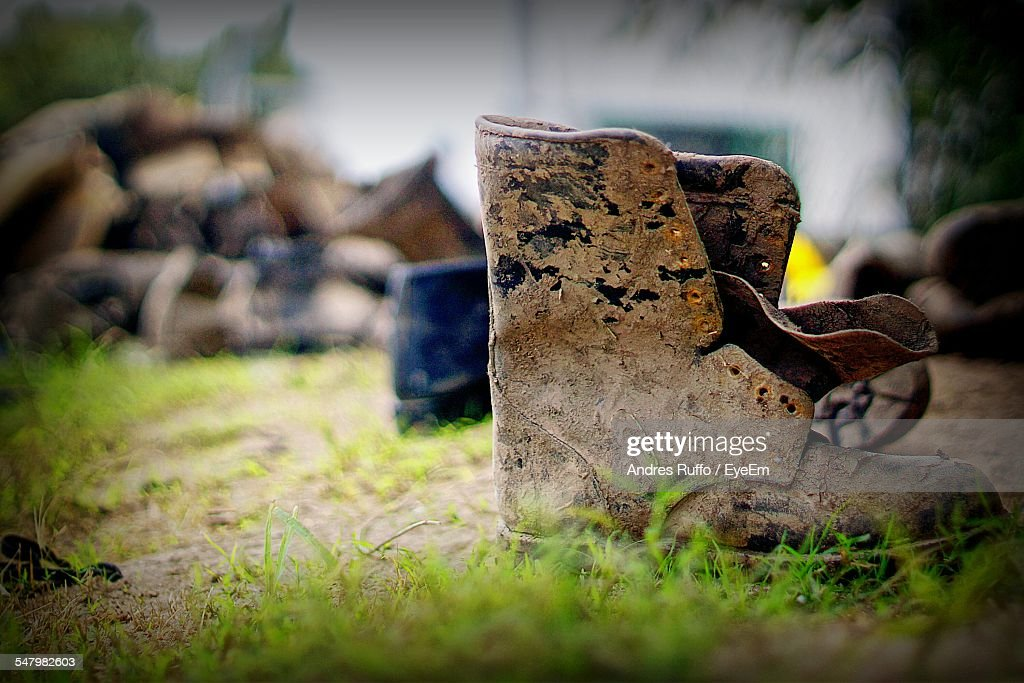 Muddy Boots On Field : Stock Photo