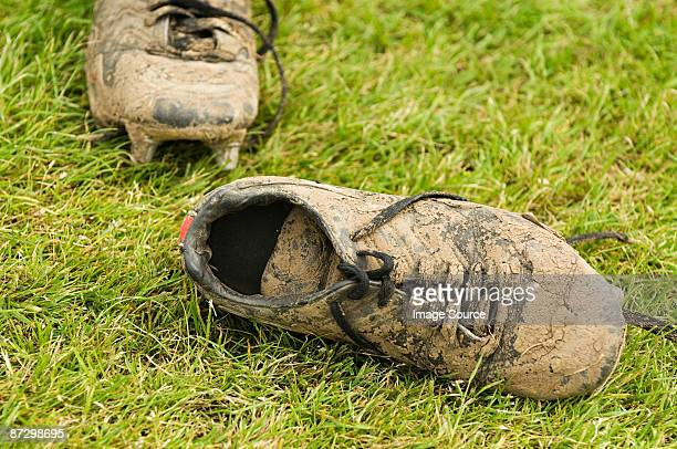muddy football boots - cleats stock pictures, royalty-free photos & images