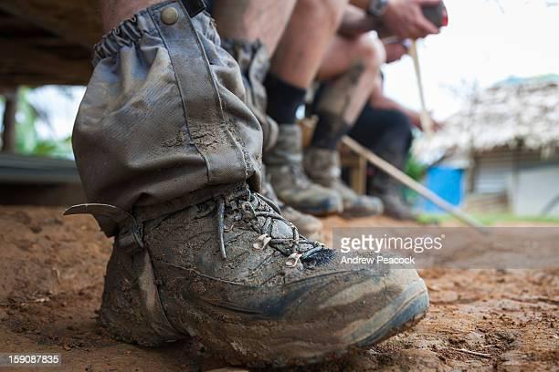 Muddy hiking boots, Nauro village, Kokoda Trail