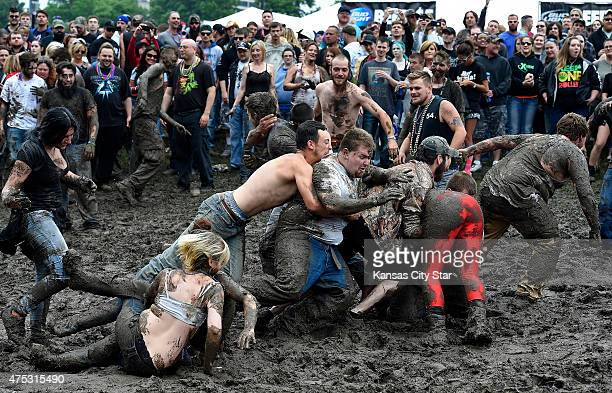 A muddy hillside became the mud wrestling spot for spectators during Rockfest on Saturday May 30 at the Liberty Memorial in Kansas City Mo