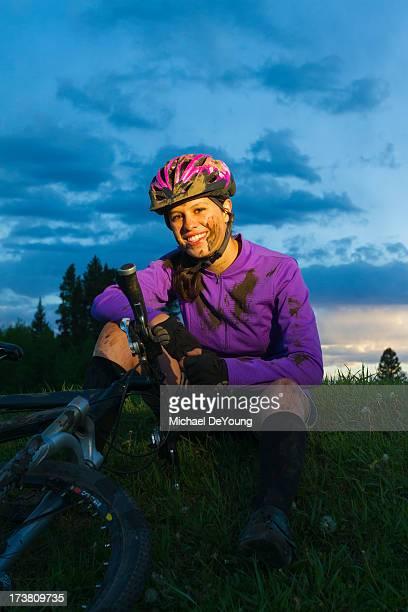 Muddy Hispanic teenager riding bicycle