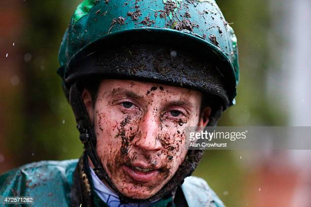 A muddy James Sulliavn returns to the weighing room at Chester racecourse on May 08 2015 in Chester England