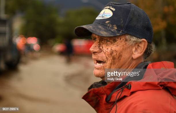 A muddy Mark Olson stands along Olive Mill Road in Montecito after trying to save his house after a major storm hit the burn area Tuesday January 9...