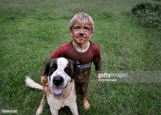 Muddy, Messy Child with Dog