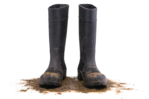 Muddy rubber boots front view 612236136