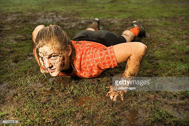Muddy soccer player on ground