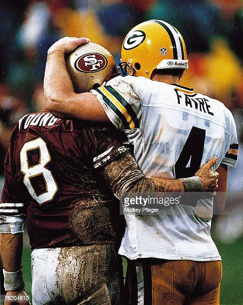 A muddy Steve Young and Brett Favre exchange words after the Green Bay Packers 2310 win over the San Francisco 49ers at 3Com Park in San Francisco...