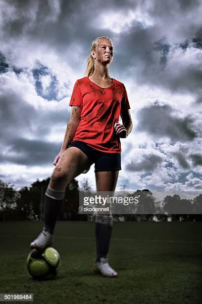 Muddy Teenage Girl with Soccer Ball