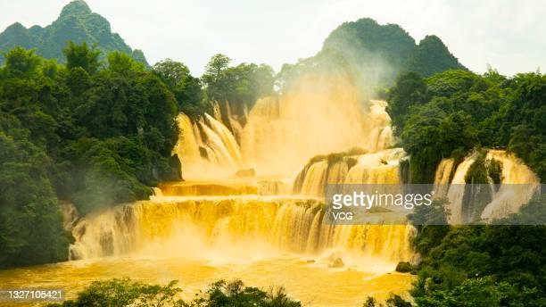 Muddy water gushes out from Detian Waterfall on July 2, 2021 in Chongzuo, Guangxi Zhuang Autonomous Region of China. The water flow of Detian...