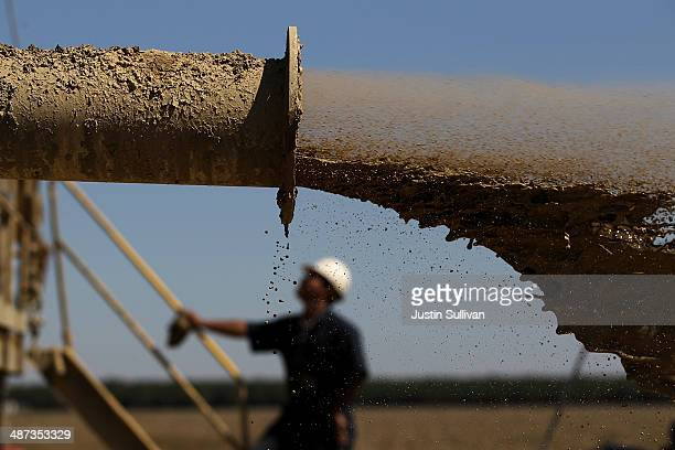 Muddy water is discharged while drilling a new well at a farm on April 29 2014 near Mendota California As the California drought continues Central...