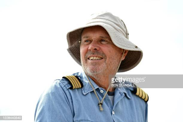 Mudeford Ferry's cruise ship tour captain Paul Derham poses for a picture following a cruise ship tour off the Dorset coast in southern England on...