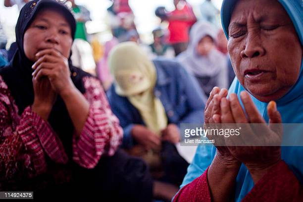 Mudflow victims pray during the 5th Anniversary of Lusi mud volcano disaster on May 29 2011 in the subdistrict of Porong in Sidoarjo East Java...