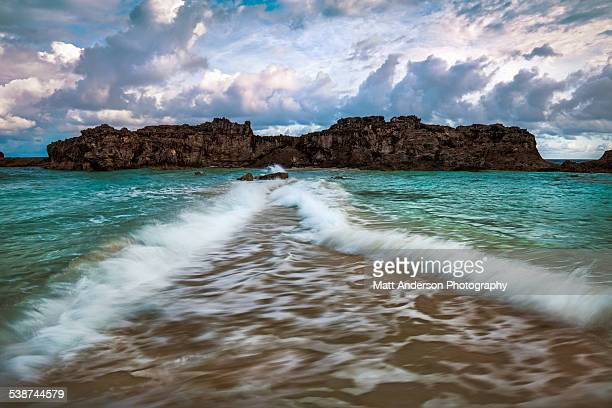 mudjin harbor tombolo, middle caicos - turks and caicos islands stock pictures, royalty-free photos & images