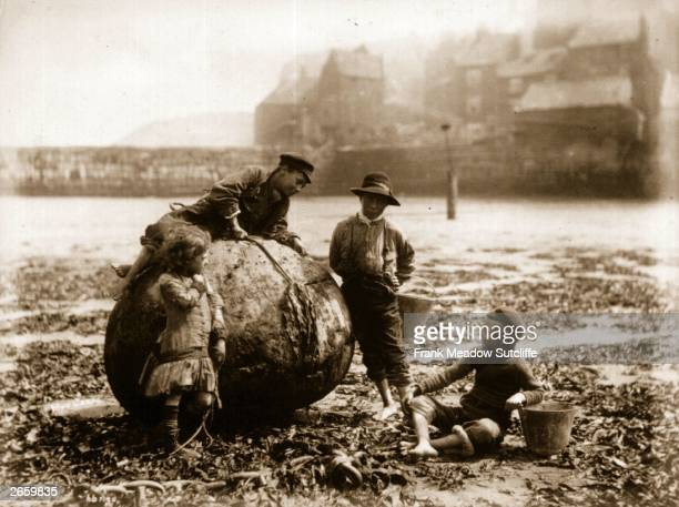 Mudlarks children who beachcomb for waste materials to resell on Tate Hill Sands Whitby North Yorkshire