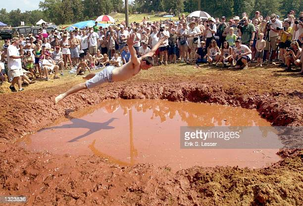 Mudpit Belly Flop competitor Ron Johnson leaps into the mud on his championship jump during the 6th annual Summer Redneck Games July 7 2001 in East...