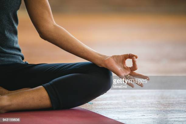 mudra and lotus pose exercises. woman practicing yoga meditation - good posture stock pictures, royalty-free photos & images