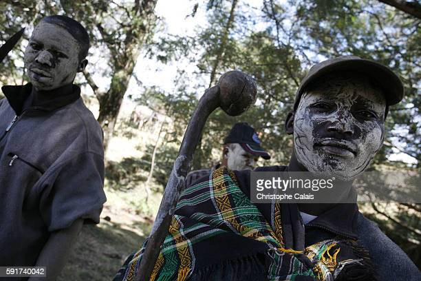 Mudsmeared Kalenjin men one with a rungu a club used to hit the enemy near the small town of Keringet in the Rift Valley The Kalenjin tribe voted...