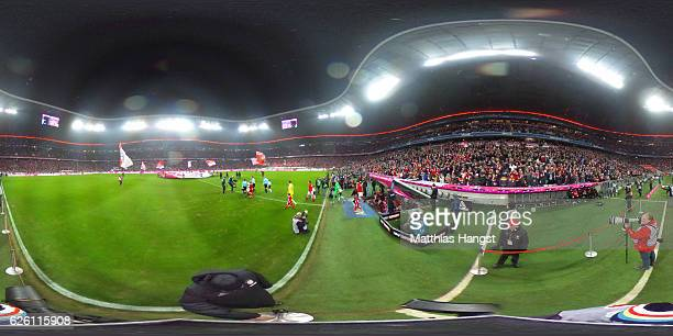 Muenchen and Leverkusen players head out to the pitch prior to the Bundesliga match between Bayern Muenchen and Bayer 04 Leverkusen at Allianz Arena...
