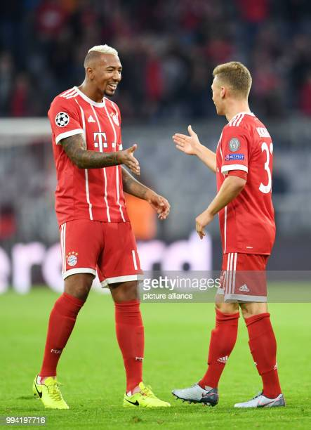Muenchen's Jerome Boateng and Joshua Kimmich celebrate Kimmich's 3-0 goal during the Champions League Group B match between Bayern Muenchen and RSC...