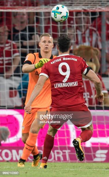 Muenchen's Robert Lewandowski and Leverkusen's goalkeeper Bernd Leno vie for the ball during the German Bundesliga soccer match between Bayern...