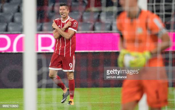 Muenchen's Robert Lewandowski celebrates his 30 goal during the German Bundesliga soccer match between Bayern Muenchen and Bayer Leverkusen in the...