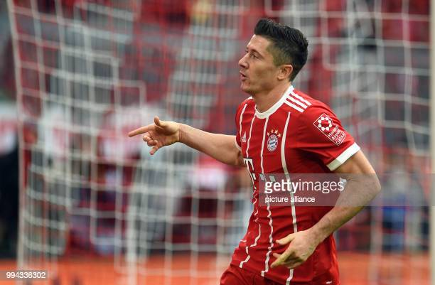 Muenchen's Robert Lewandowski celebreates his 40 goal during the German Bundesliga soccer match between Bayern Muenchen and FSV Mainz 05 in the...
