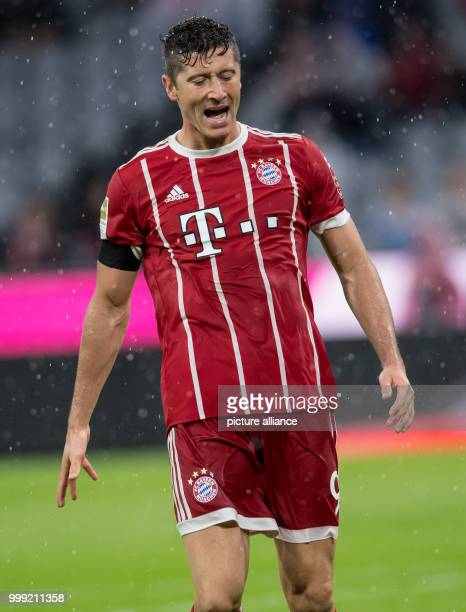 Muenchen's Robert Lewandowski gestures on the pitch during the German Bundesliga soccer match between Bayern Muenchen and Bayer Leverkusen in the...
