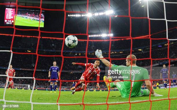 Muenchen's Thiago scores the 20 against Anderlecht's goalkeeper Mats Sels during the Champions League Group B match between Bayern Muenchen and RSC...
