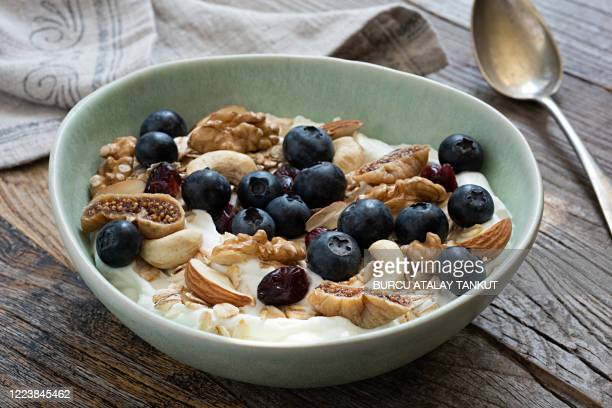 muesli bowl with blueberries and nuts - granola stock pictures, royalty-free photos & images